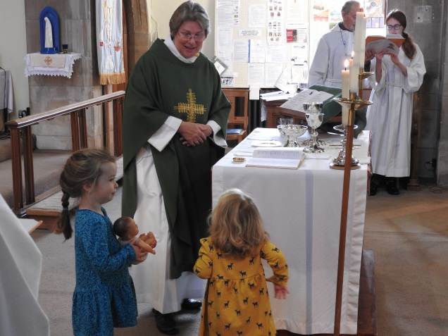 young helpers at an informal Eucharist